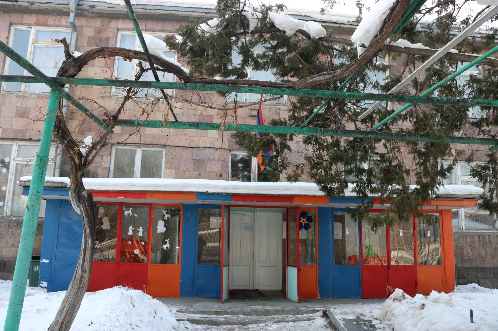 The ouside entrance of a school in the winter time with snow on the ground
