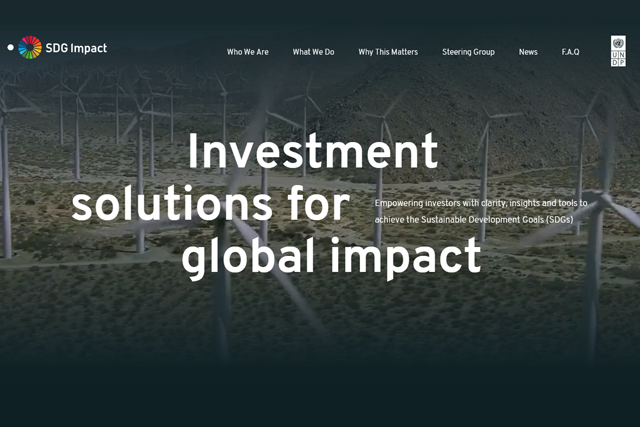 "A field with windmills generating renewable energy and the title ""Investment solutions for global impact"""